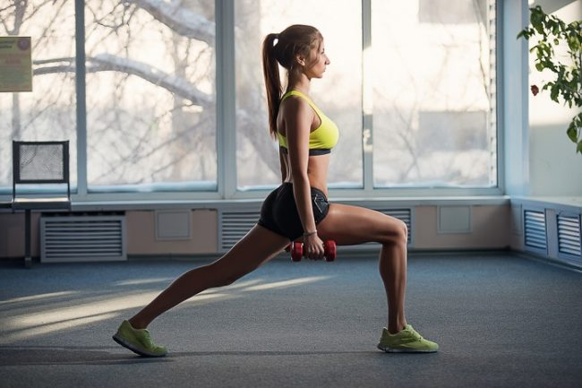 fit woman doing lunges
