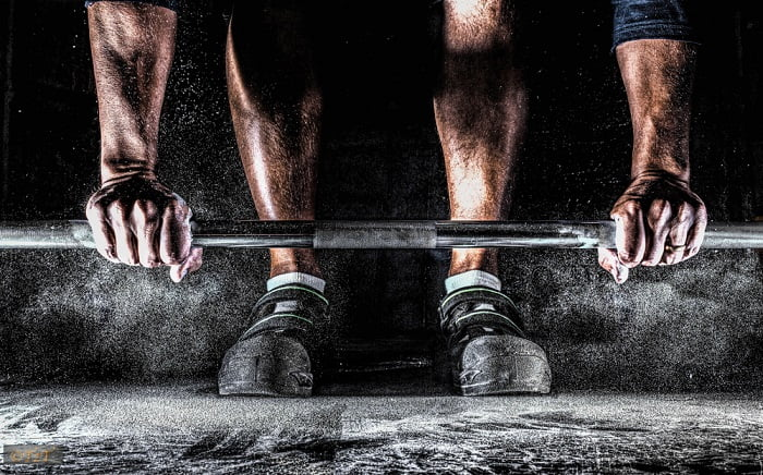 legs and hands of a man weightlifting