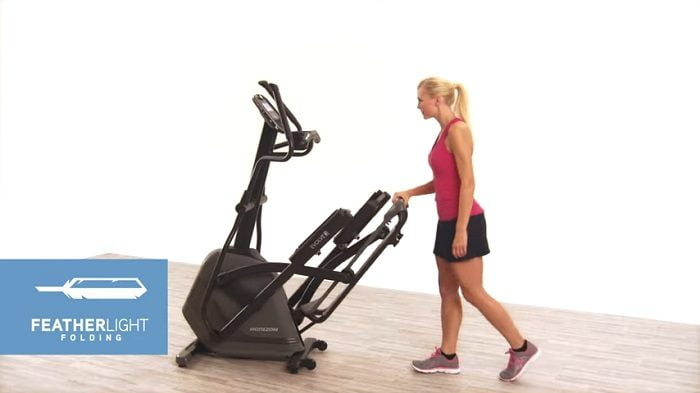 woman demonstrating folding feature of horizon evolve 3 elliptical