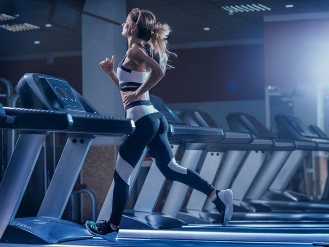 young woman using a treadmill