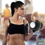 slim woman performing dumbbell curl with ativafit dumbbell