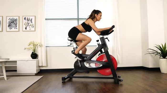 woman exercising on a spin bike