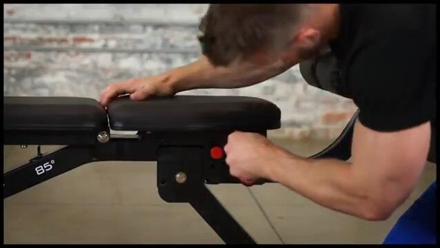 man demonstrating no gap seat f fitness reality weight bench