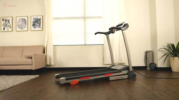 sunny health sf-t4400 treadmill in front room of house