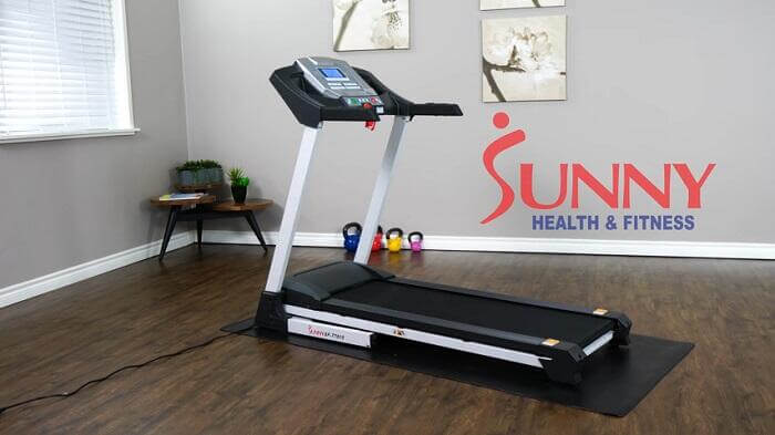 Sunny Health & Fitness SF-T7515 Smart Treadmill with Auto Incline in front room of house