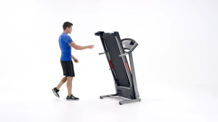 man folding weslo treadmill g 5.9i