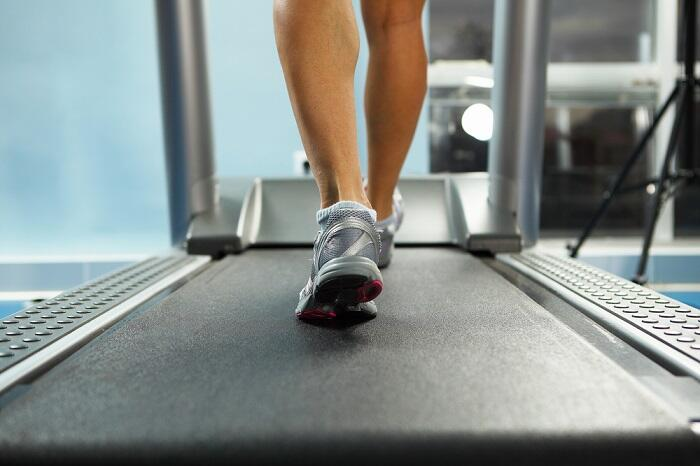 woman walking on treadmill in home gym