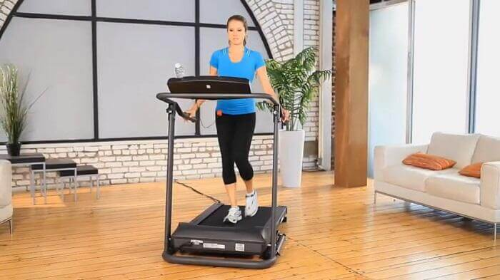 Woman walking on exerpeutic tf1000 treadmill