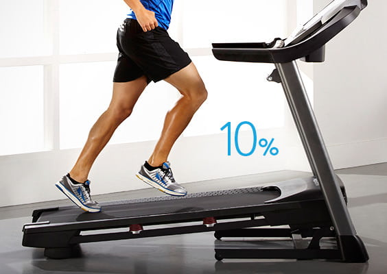 man walking up 10% power adjustable incline treadmill