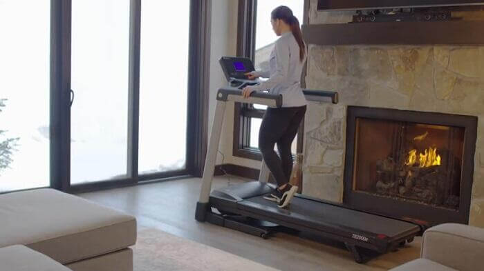 woman walking on lifespan TR2000e treadmill in front room of house
