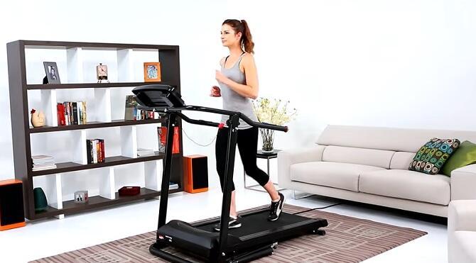 woman walking on Progear HCXL 4000 treadmill in her front room
