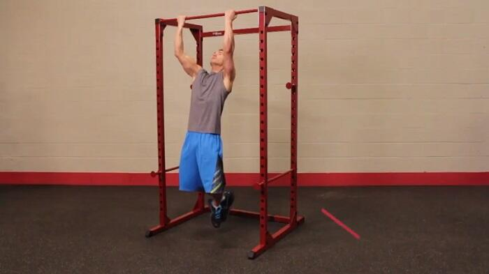 man performing pull ups on best fitness power rack BFPR100