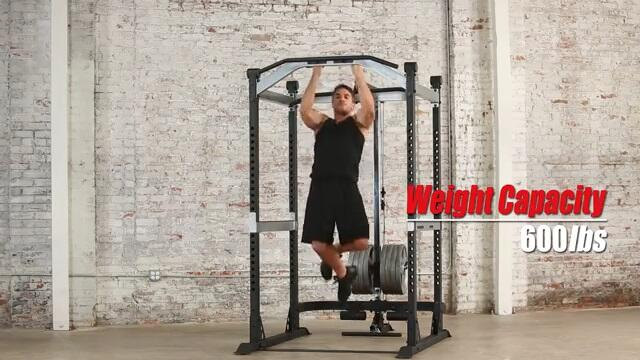 man performing pulls on fitness reality power rack chinning bar
