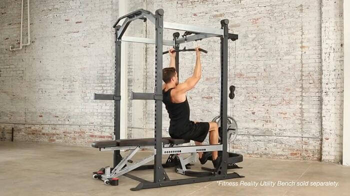 man demonstrating fitness reality x class power rack lat pull down