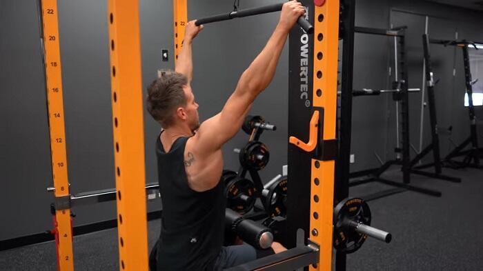 man performing lat pulldowns on powertec power rack