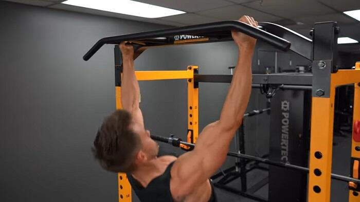 man performing pull ups on powertec power rack