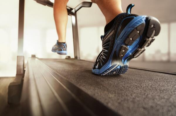 man walking on incline treadmill at home