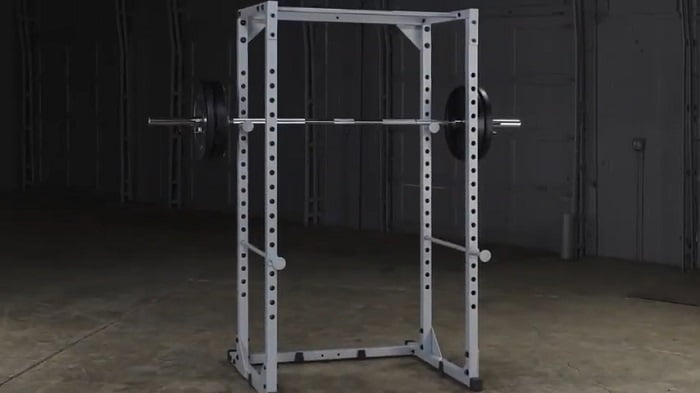 Body-solid powerline 200 power rack with loaded barbell