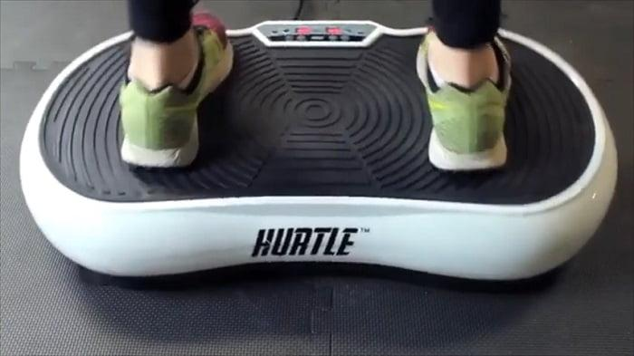 woman standing on Hurtle Fitness Vibration Platform