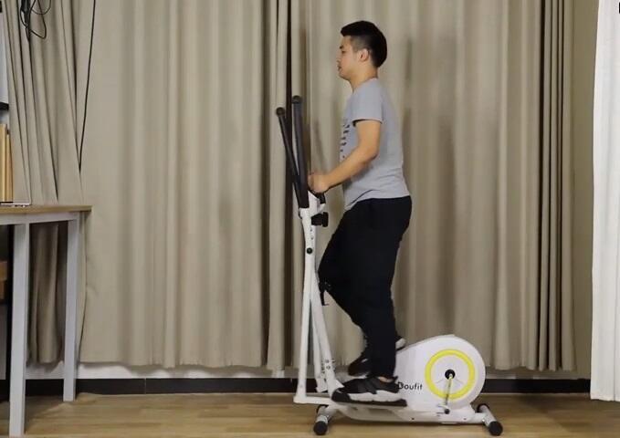 man exercising on Doufit elliptical machine