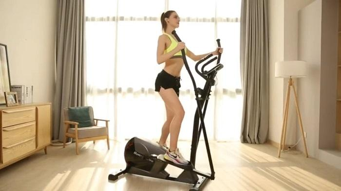 woman exercising on snode e16 elliptical in her front room