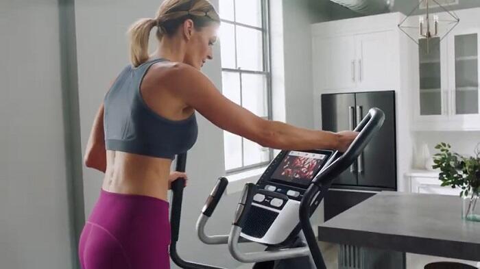 elliptical workout in kitchen