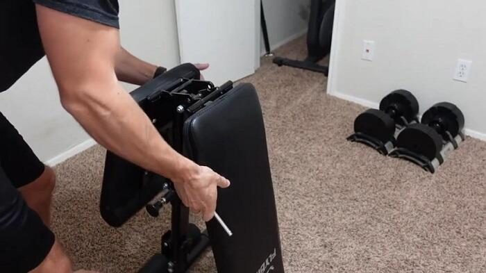 man folding flybird adjustable weight bench