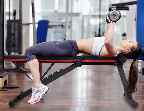 woman dumbbell pressing on pasyou adjustable weight bench