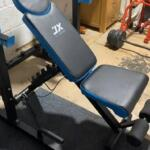 JX fitness weight bench in home gym