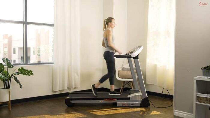 woman walking on sunny health electric treadmill treadmill
