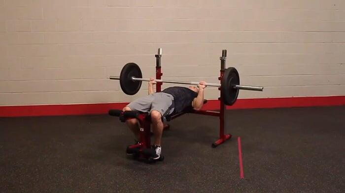 man performing bench press on best fitness Olympic bench