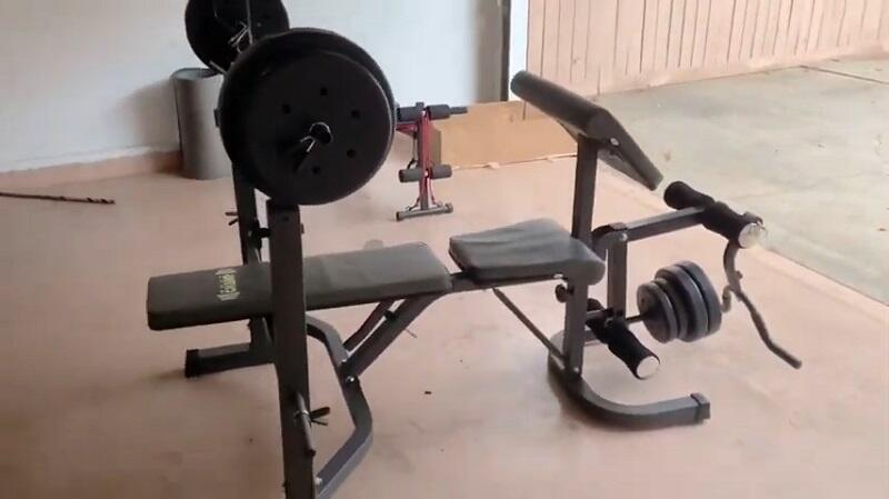 body champ Olympic weight bench in home gym
