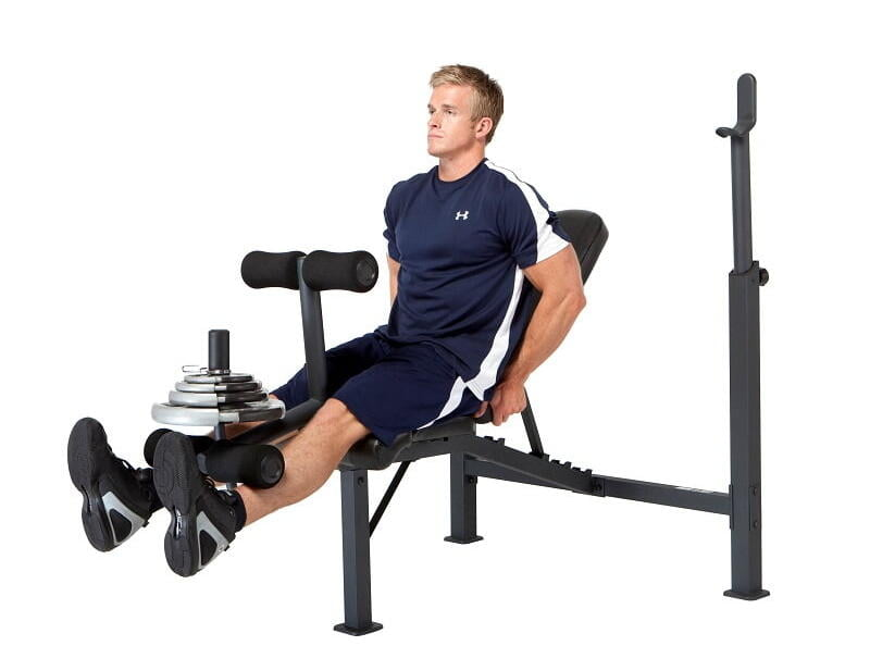 man performing leg curls on impex Competitor weight bench