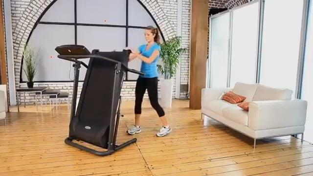 woman folding Exerpeutic TF1000 treadmill