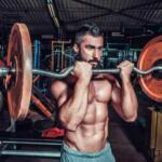 fit man holding a weight