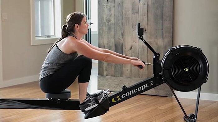 woman rowing on concept 2 model d at home