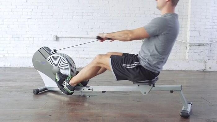 man rowing on stamina ATS 1399 rowing machine