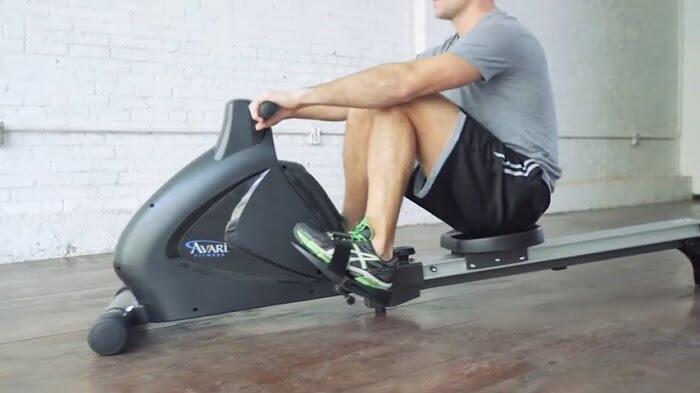 man rowing on stamina avari rowing machine