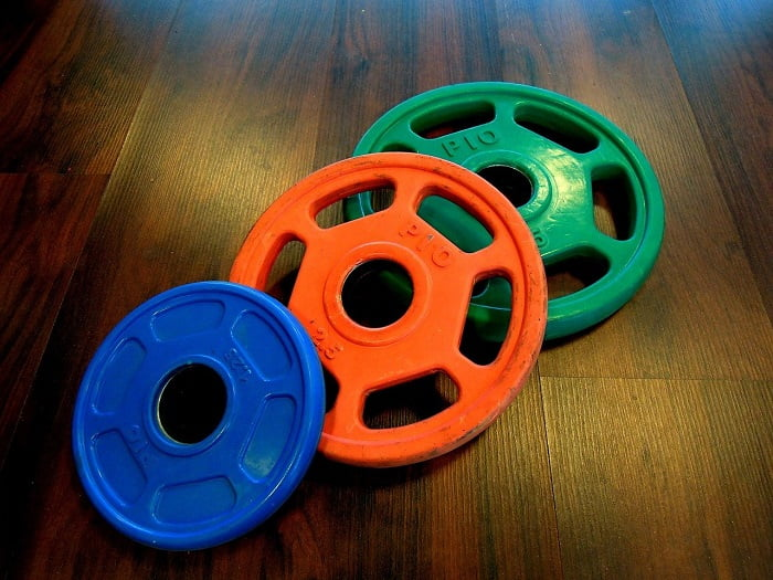 three different size and colour weight plates