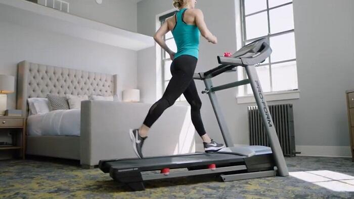 woman running on proform 400i treadmill at home